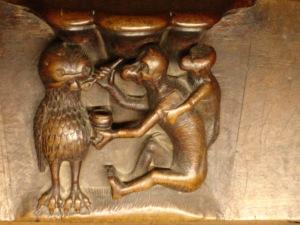 Mono dando de comer a la lechuza. (Catedral de Toledo, detalle Coro)